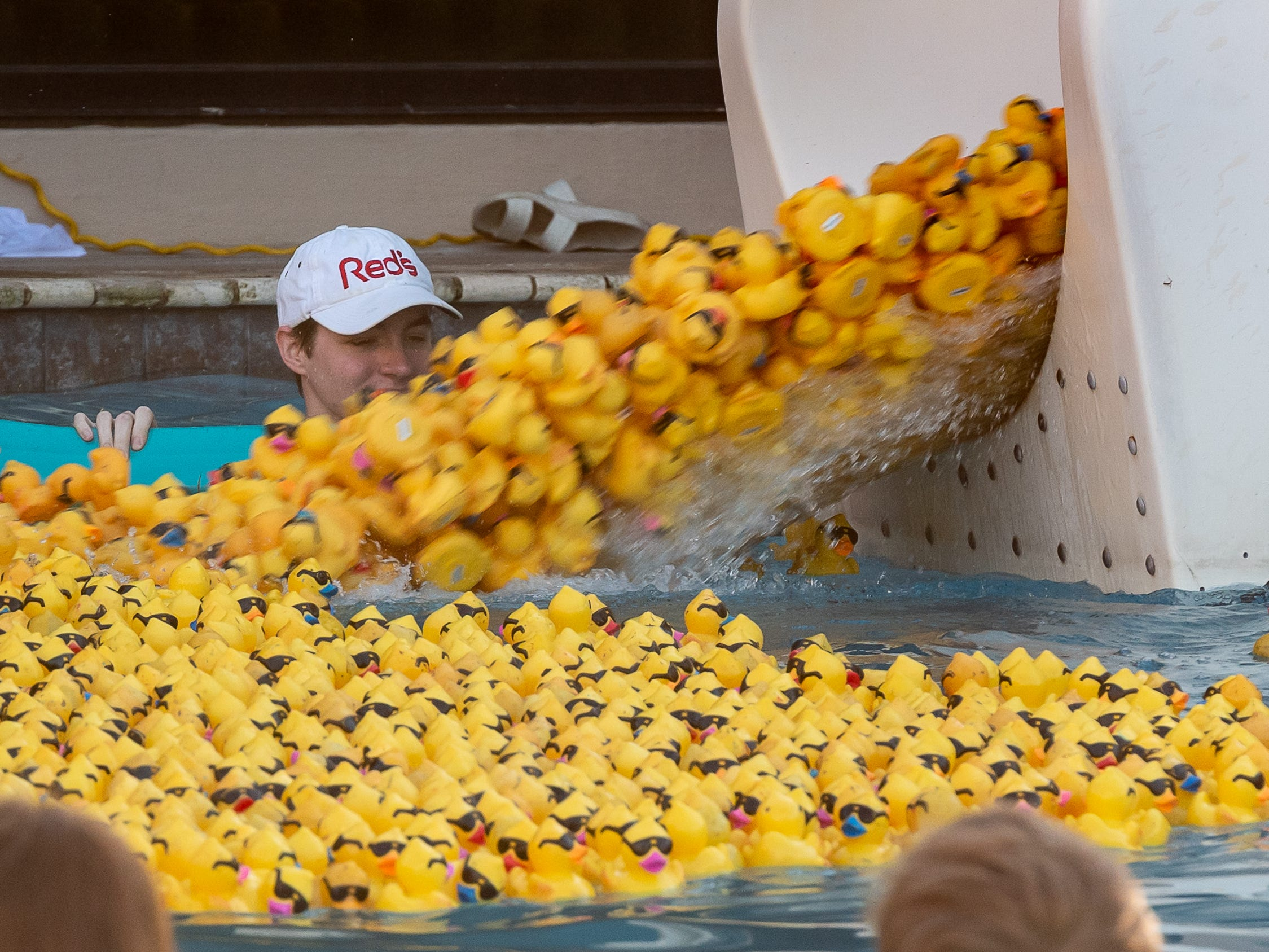 The ducks are released from the giant water slide at The Great Acadiana Running of the Ducks. Wednesday, April 10, 2019.