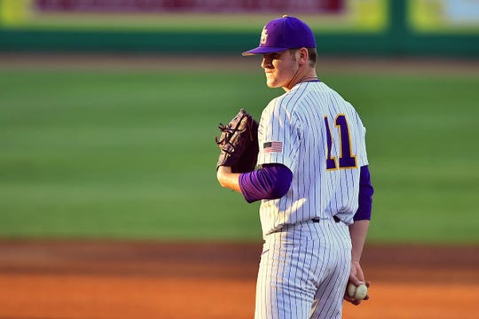 LSU freshman pitcher Landon Marceaux stands on the mound.