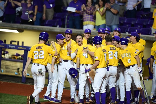 The LSU baseball team celebrates a home run by Josh Smith, No. 4, during a game against Texas A&M on Saturday, April 6, in Baton Rouge, Louisiana.
