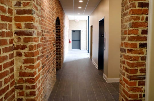 The exposed brick wall on the back of each of the Mithoff building's three floors is made from bricks salvaged from a section of the building that was demolished during renovation.