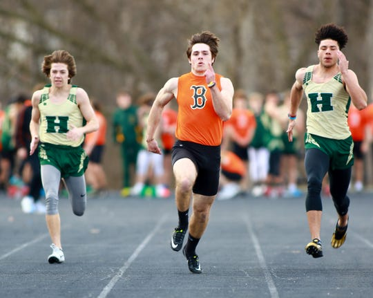Brighton's Chris Seguin (center) won the 100- and 200-meter dashes against Howell on Tuesday, April 9, 2019.