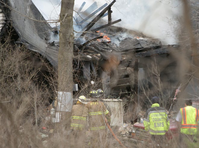 Firefighters from Putnam, Unadilla, Hamburg ,Howell and Dexter worked a fire at an abandoned home on Hinchey Rd. in Putnam Township Wednesday, April 10, 2019.
