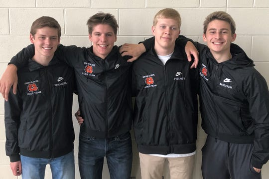 Brighton's 400-yard freestyle relay team consists of (from left) Scott Spaanstra, Drew Panzl, Remy Fischer and Leighton Brien.