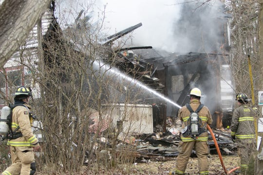 An abandoned house on Hinchey Rd. in Putnam Twp. was destroyed by fire Wednesday, April 10, 2019.