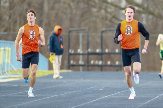 Will Jontz (right) edged his brother, Matt, in the 400-meter run at Howell on Tuesday, April 9, 2019.