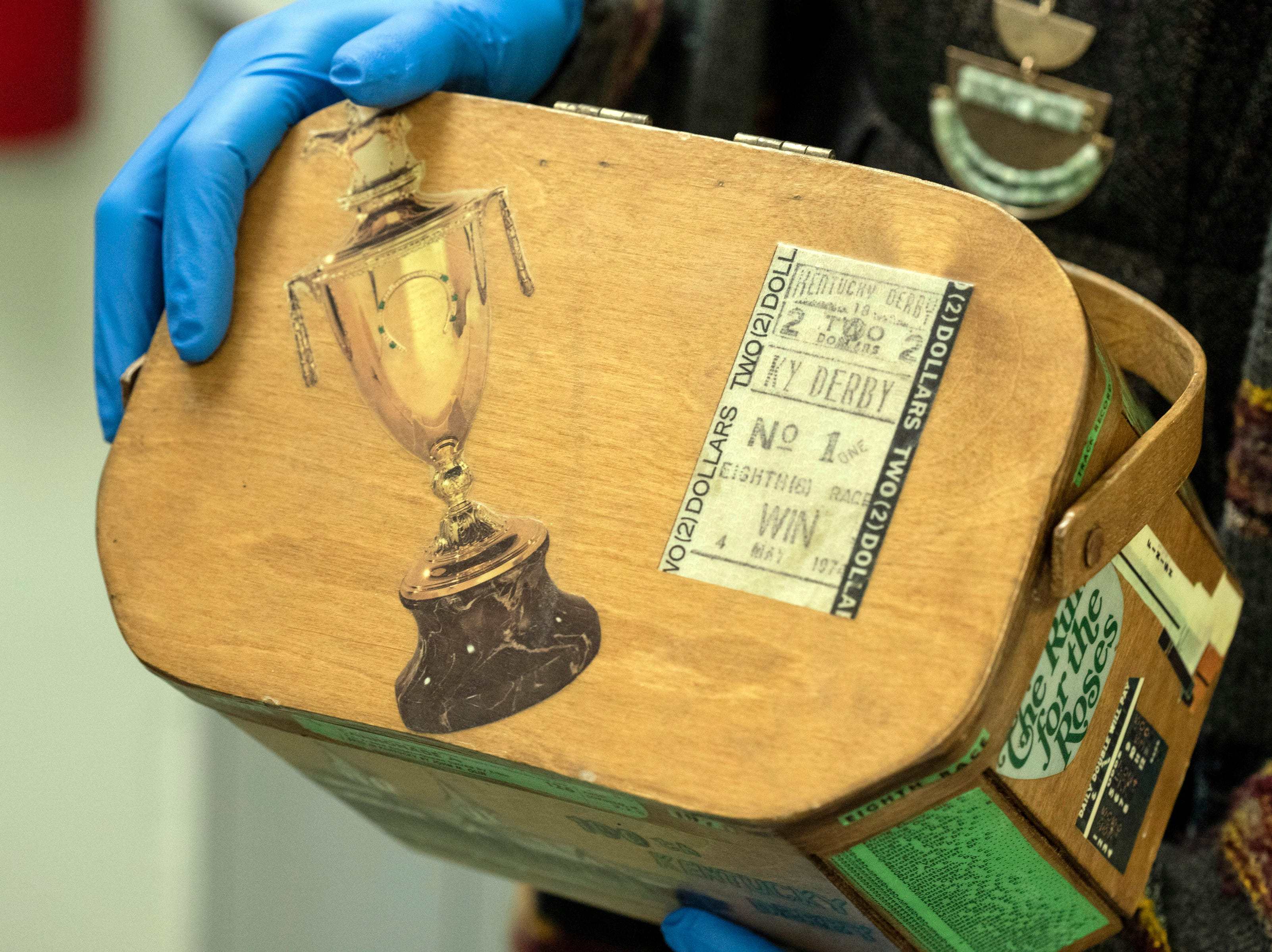 A decorative box designed by a fan to commemorate the 100th running of the Kentucky Derby is one of the many items stashed away in the Derby Museum archives. 3/26/19