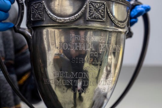 A trophy awarded in 1919 to the first Triple Crown winner Sir Barton is being researched by the staff at the Kentucky Derby Museum to understand its origins. The trophy was awarded to Sir Barton's owner JKL Ross by a harness track in Philadelphia but celebrates his Belmont Stakes win. 3/26/19