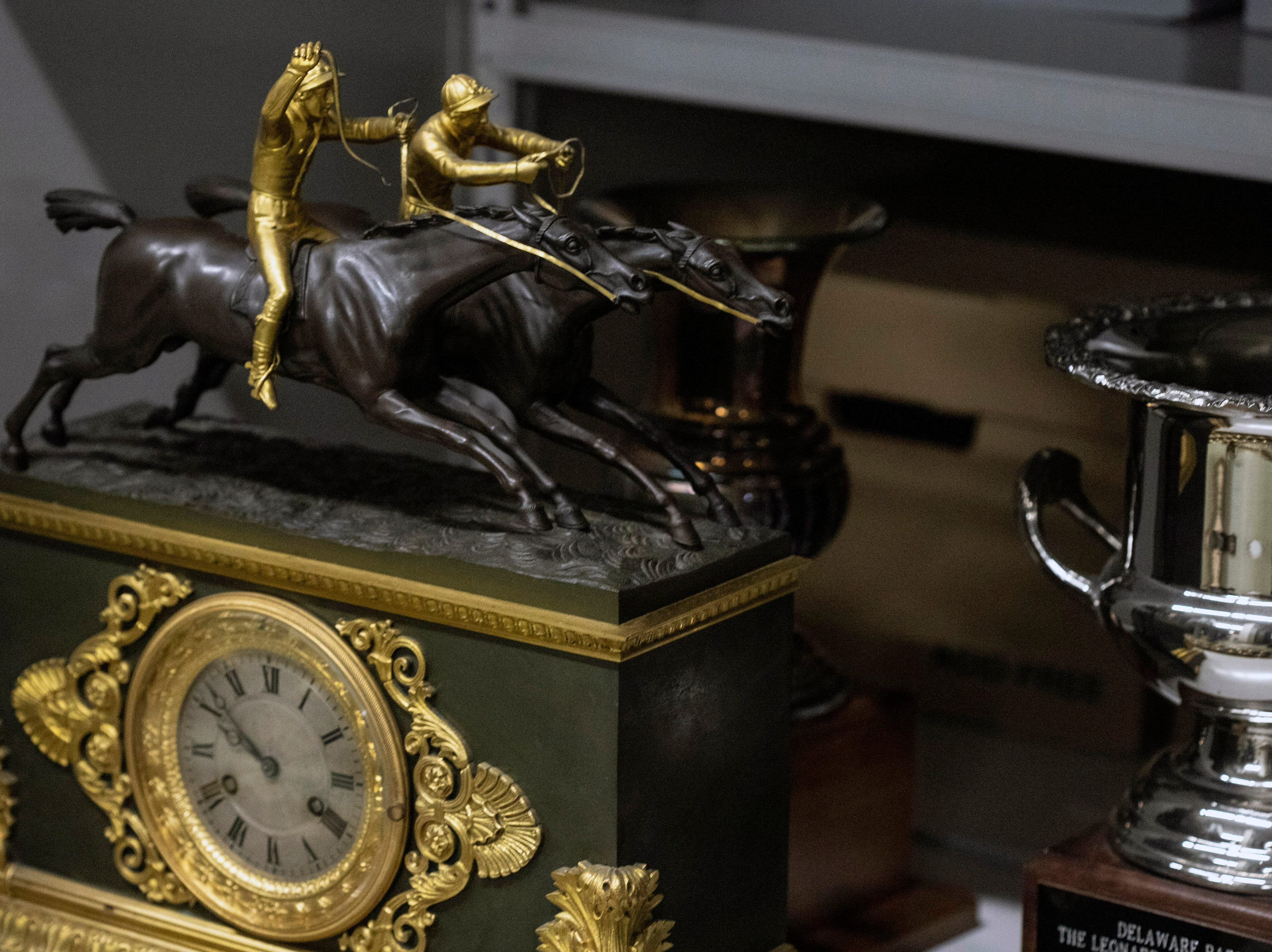 A variety of horse racing themed items can be found on the shelves of the Kentucky Derby Museum archives. 3/26/19