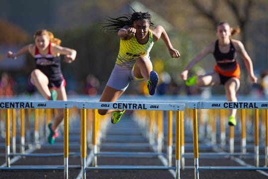 Central High School's Kayla Jones wins her heat in the 100 hurdles during the Lenny Lyles Track and Field meet at Central High School on Tuesday evening. April 9, 2019