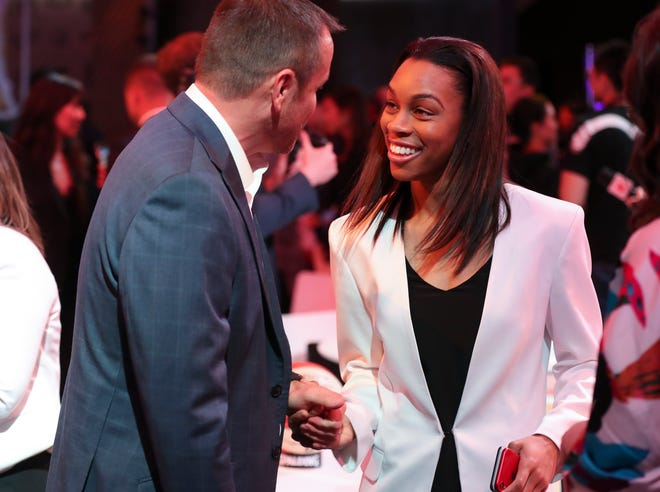U of L's Asia Durr, right, reacted as head coach Jeff Walz showed up to join her as she waited for her name to be called during the WNBA Draft in New York City.  She was selected as the second pick by the New York Liberty. April 10, 2019
