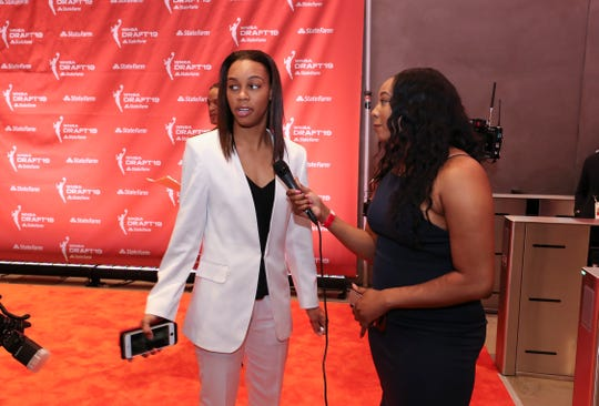 U of L's Asia Durr, left, was interviewed on the orange carpet as she arrived at the WNBA Draft in New York City. April 10, 2019