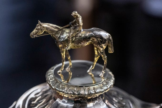 Trophies topped with horses and jockeys can be found by the dozen in the archives of the Kentucky Derby Museum. 3/26/19