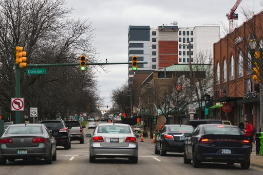 New construction takes place along Grand River Avenue in East Lansing, Wednesday, April 10, 2019.