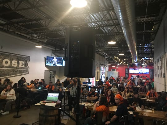 Members of The Assembly Line gather at Lansing Brewing Company for a watch party for Lansing Ignite's first match vs. Richmond on March 30.