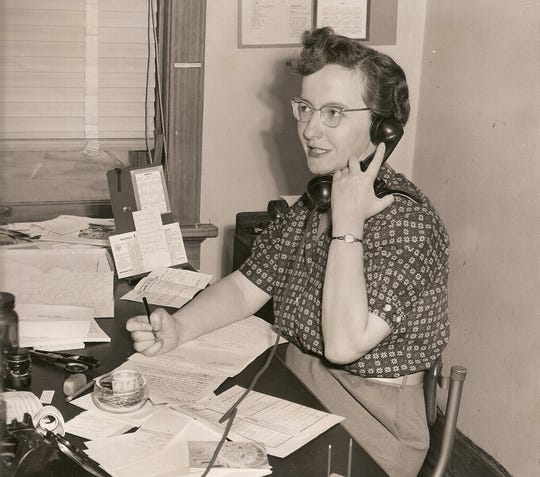 Marge Miley at her desk as the Herald Times Society editor in 1957.