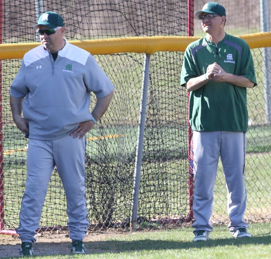 Madison head coach Doug Rickert and assistant coach Rob Siwek discuss strategy during a baseball game against Lexington earlier this spring.