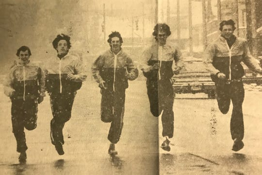 This April, 1982 News Journal photo shows athletes from Central Wellington District High School in Fergus, Ontario, Canada running down the middle of Park Avenue West after a snowstorm forced cancellation of the Mehock Relays that year. Benny Ralston, who is bringing a Canadian team to town for Saturday's 87th Mehock, remembers that meet well.