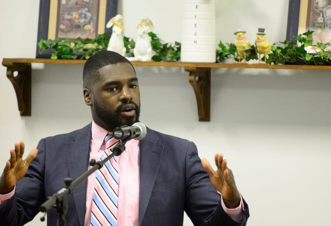 Alomar Davenport, a candidate for council's 4th Ward, was found asleep behind the wheel of a running car early Sunday morning. Police say Davenport refused to answer questions and was asked several times to identify himself.