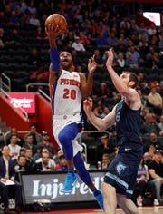 Detroit Pistons guard Wayne Ellington (20) drives on Memphis Grizzlies center Tyler Zeller (45) in the first half of an NBA basketball game in Detroit, Tuesday, April 9, 2019. (AP Photo/Paul Sancya)