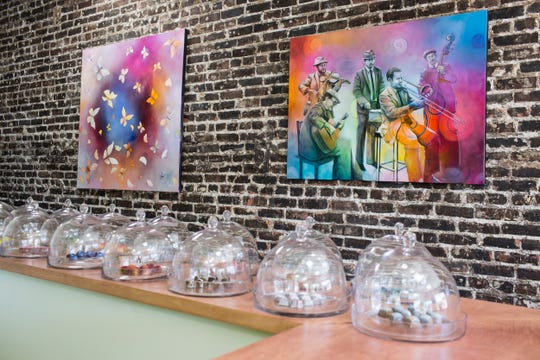 April 09, 2019 - Artwork by Danny Broadway is seen on the walls of the new Phillip Ashley Chocolates boutique at 1200 Madison Avenue.