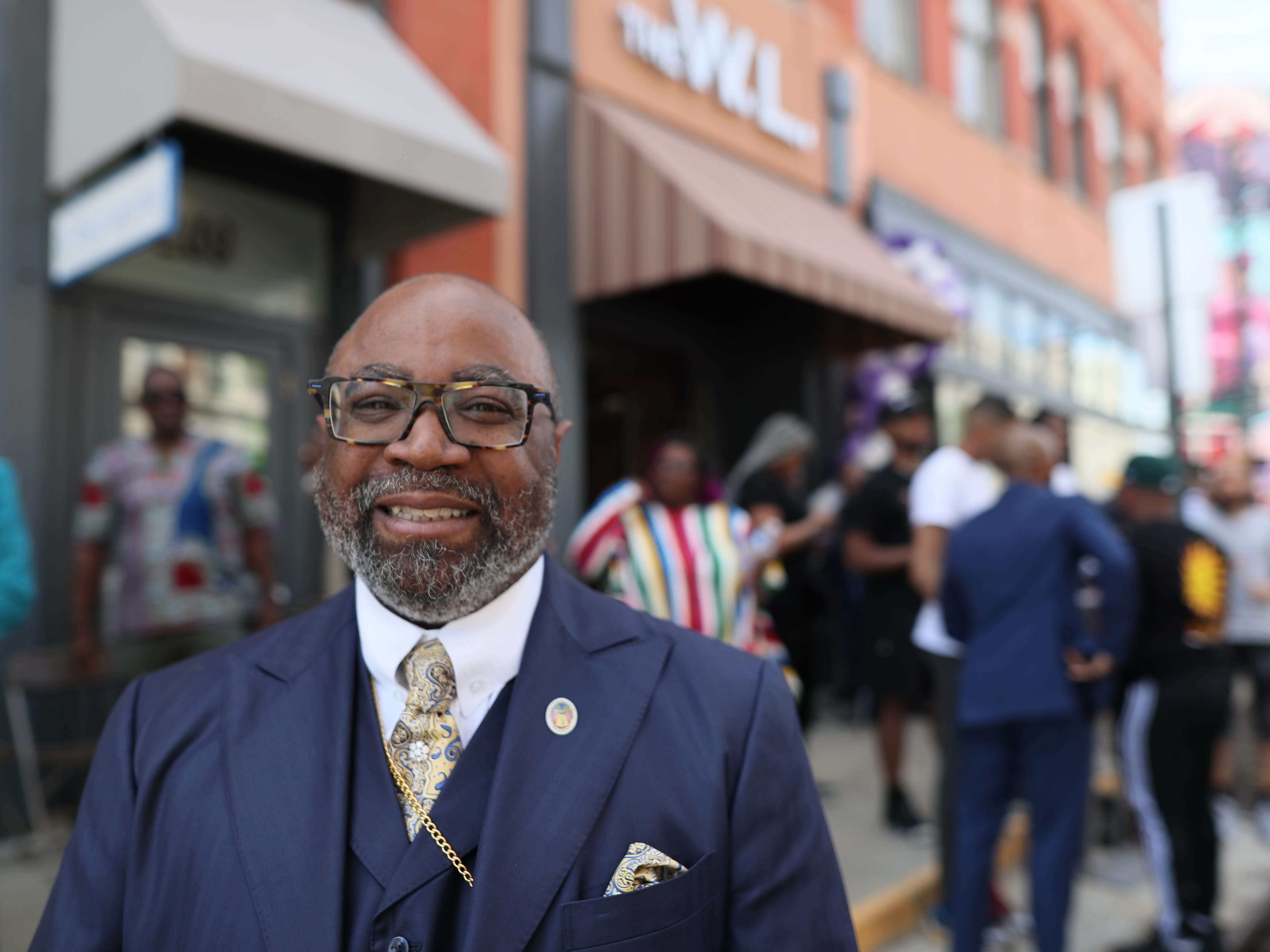Bishop Brandon Porter stands along South Main Street downtown where the the Adler Building is renamed 'The W.L.' in honor of his late father, Bishop W.L. Porter, on Wednesday, April 10, 2019.