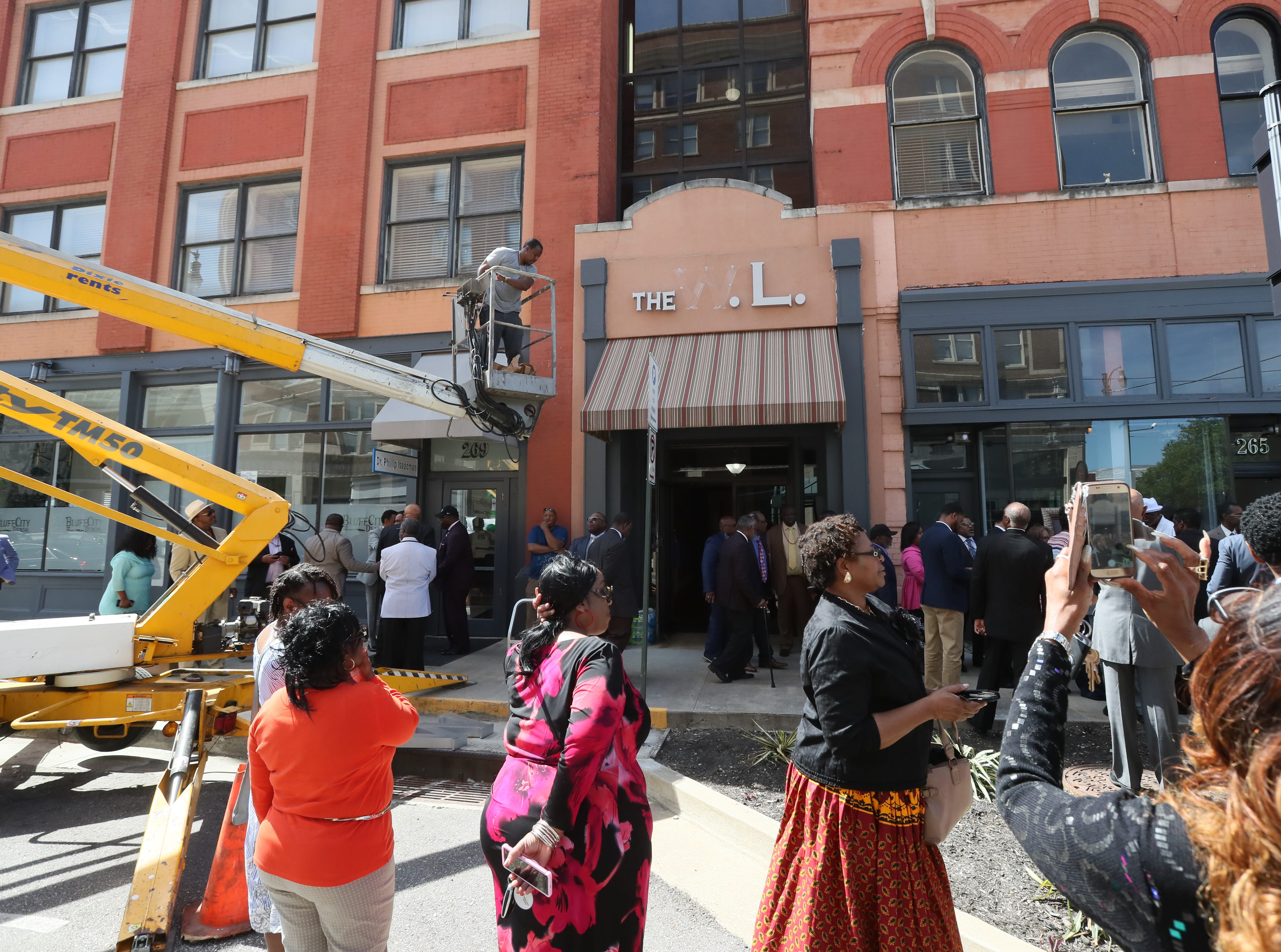People gather on South Main Street downtown as the the Adler Building is renamed 'The W.L.' in honor of the late Bishop W.L. Porter on Wednesday, April 10, 2019.