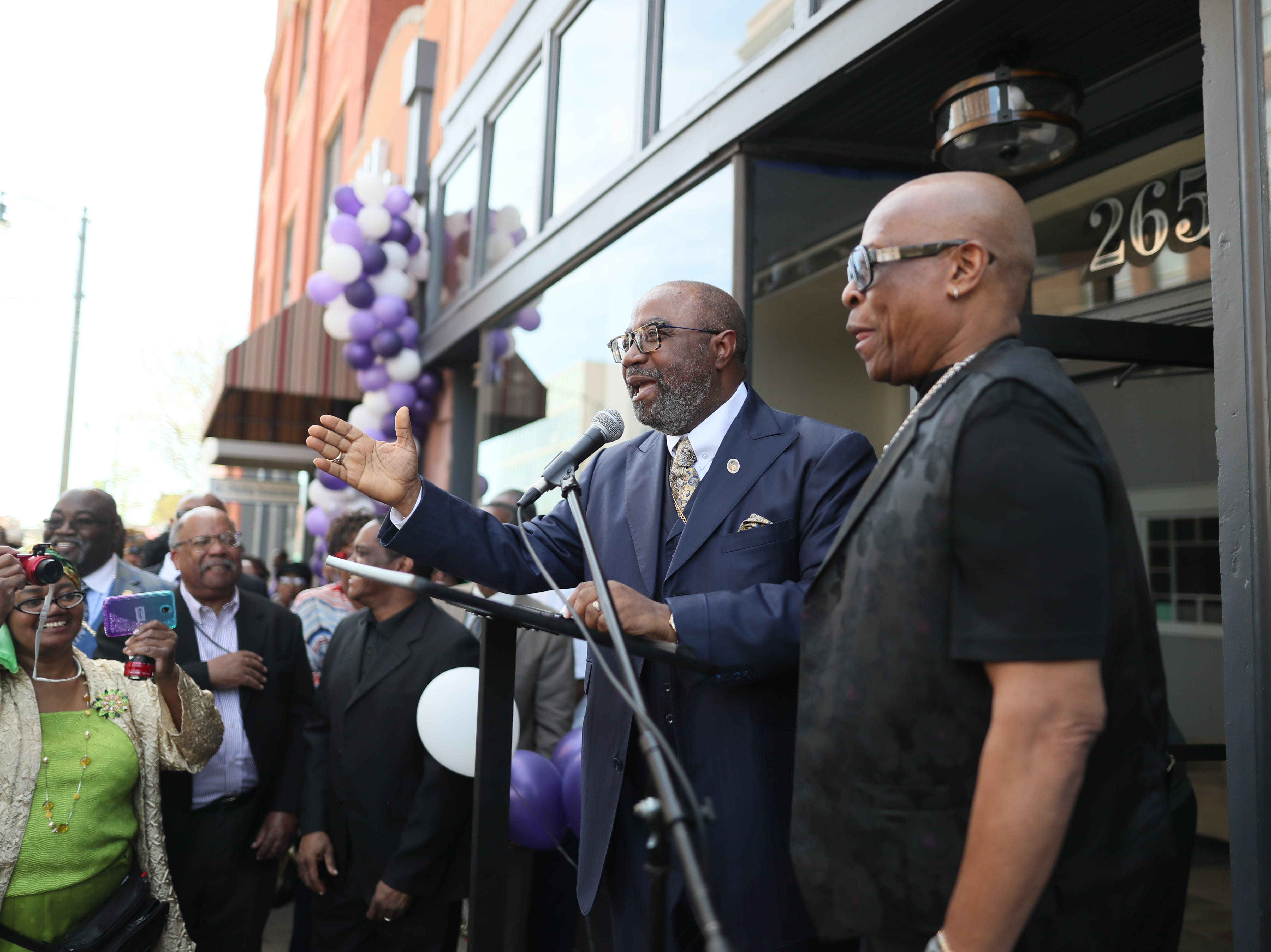 Bishop Brandon Porter and his uncle David Porter speak to people gathered on South Main Street downtown as the the Adler Building is renamed 'The W.L.' in honor of Bishop W.L. Porter on Wednesday, April 10, 2019.