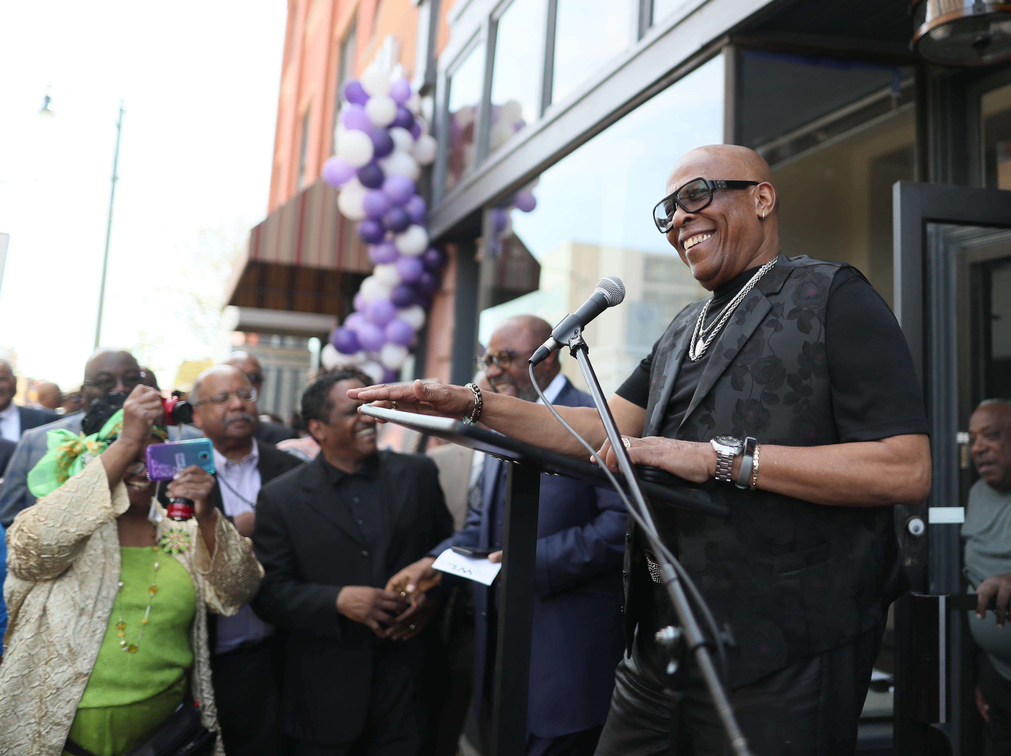 David Porter speaks to people gathered on South Main Street downtown as the the Adler Building is renamed 'The W.L.' in honor of his late brother, Bishop W.L. Porter, on Wednesday, April 10, 2019.