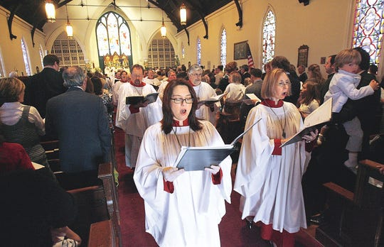 Choir members lead the procession at the conclusion of the Sunday morning Easter Service at Calvary Episcopal Church in downtown Memphis.
