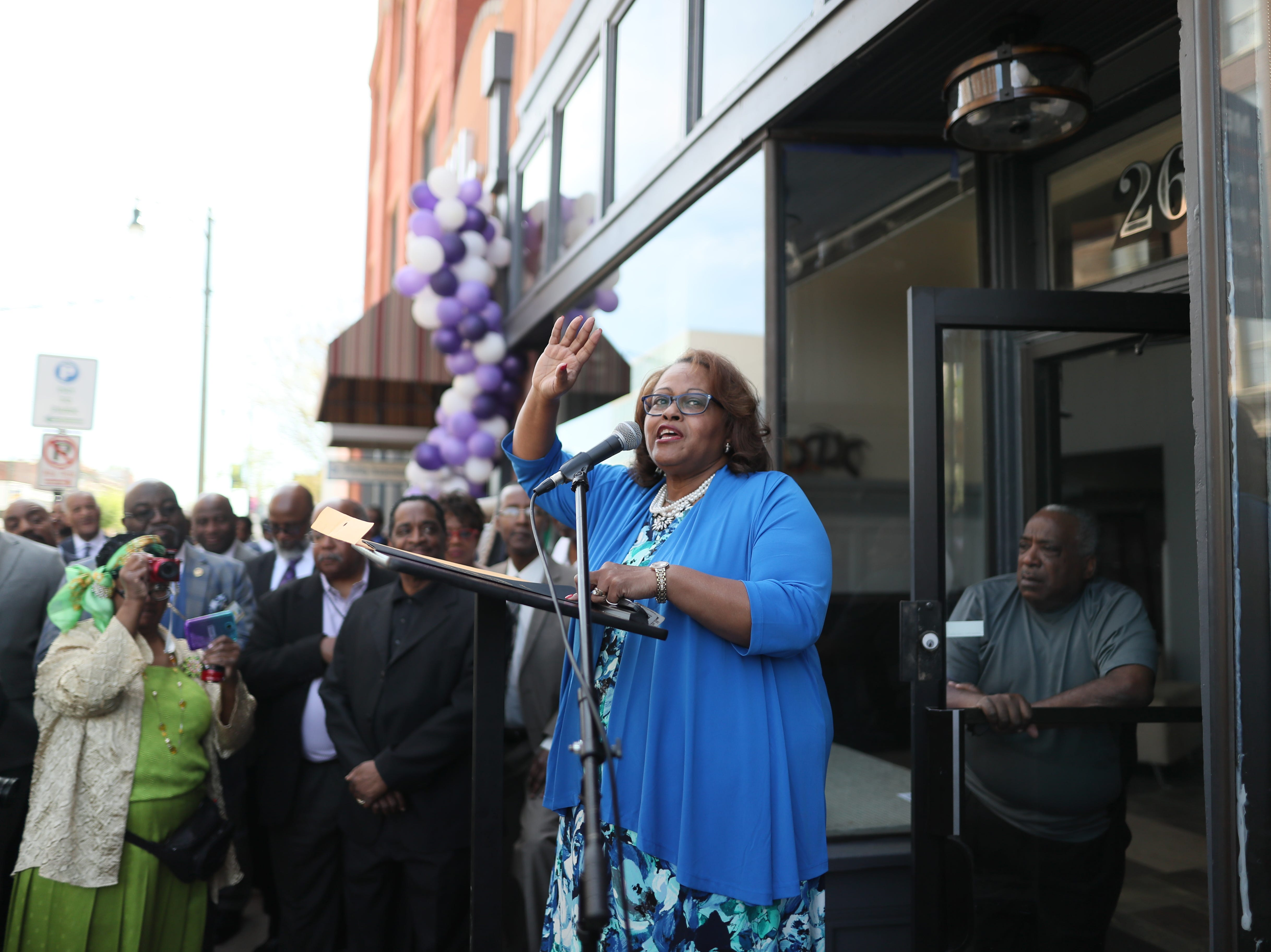 City Councilwoman Patrice Robinson speaks to people gathered on South Main Street downtown as the Adler Building is renamed 'The W.L.' in honor of his late father, Bishop W.L. Porter, on Wednesday, April 10, 2019.