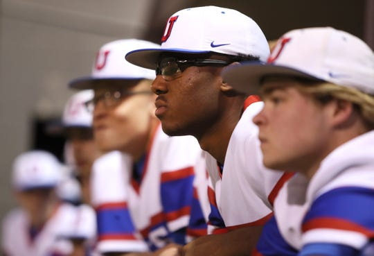 Memphis University School's Maurice Hampton watches his teammates bat against St. Benedict at MUS on Tuesday, April 9, 2019.