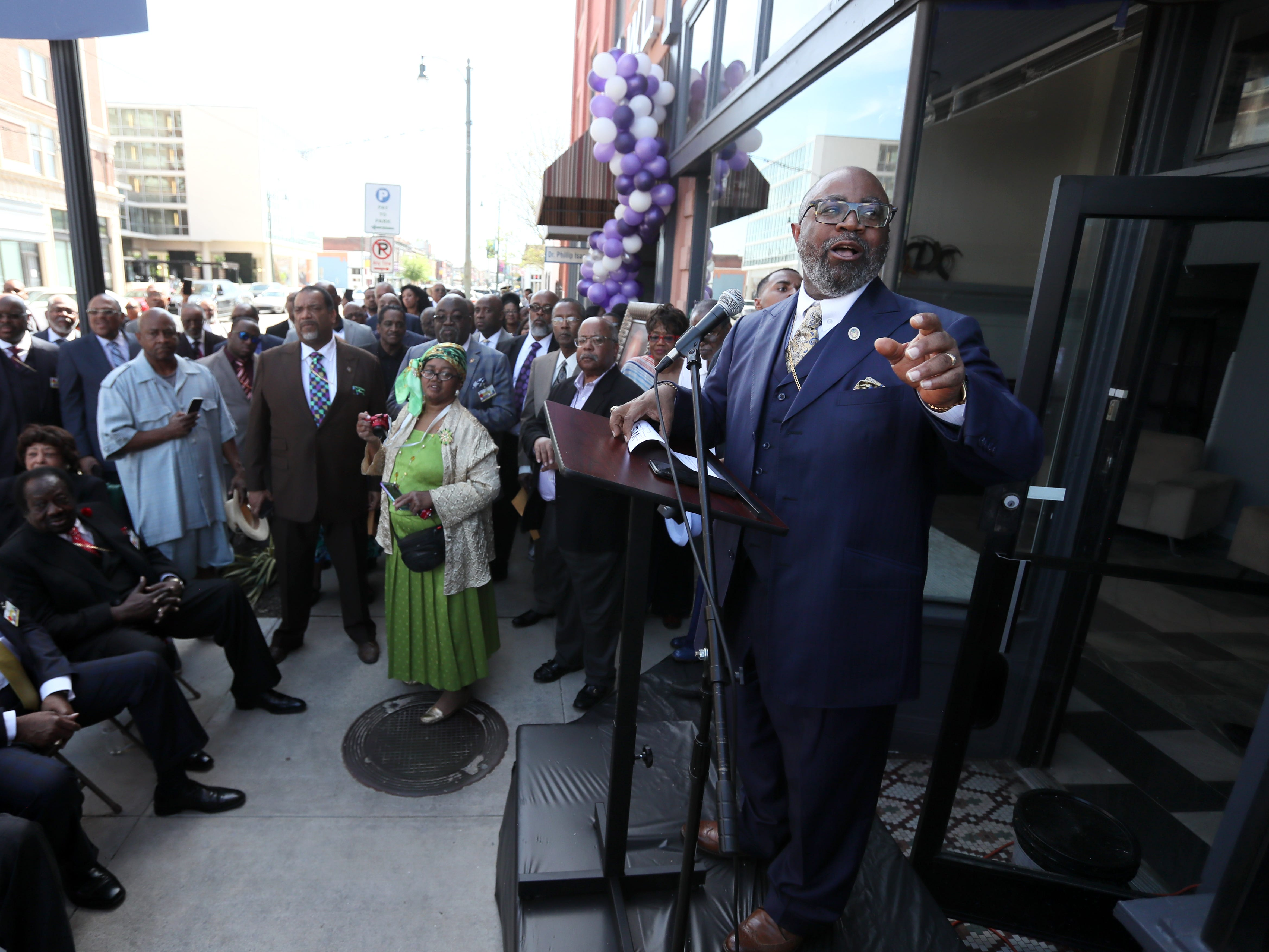Bishop Brandon Porter speaks to people gathered on South Main Street downtown as the the Adler Building is renamed 'The W.L.' in honor of his late father, Bishop W.L. Porter, on Wednesday, April 10, 2019.