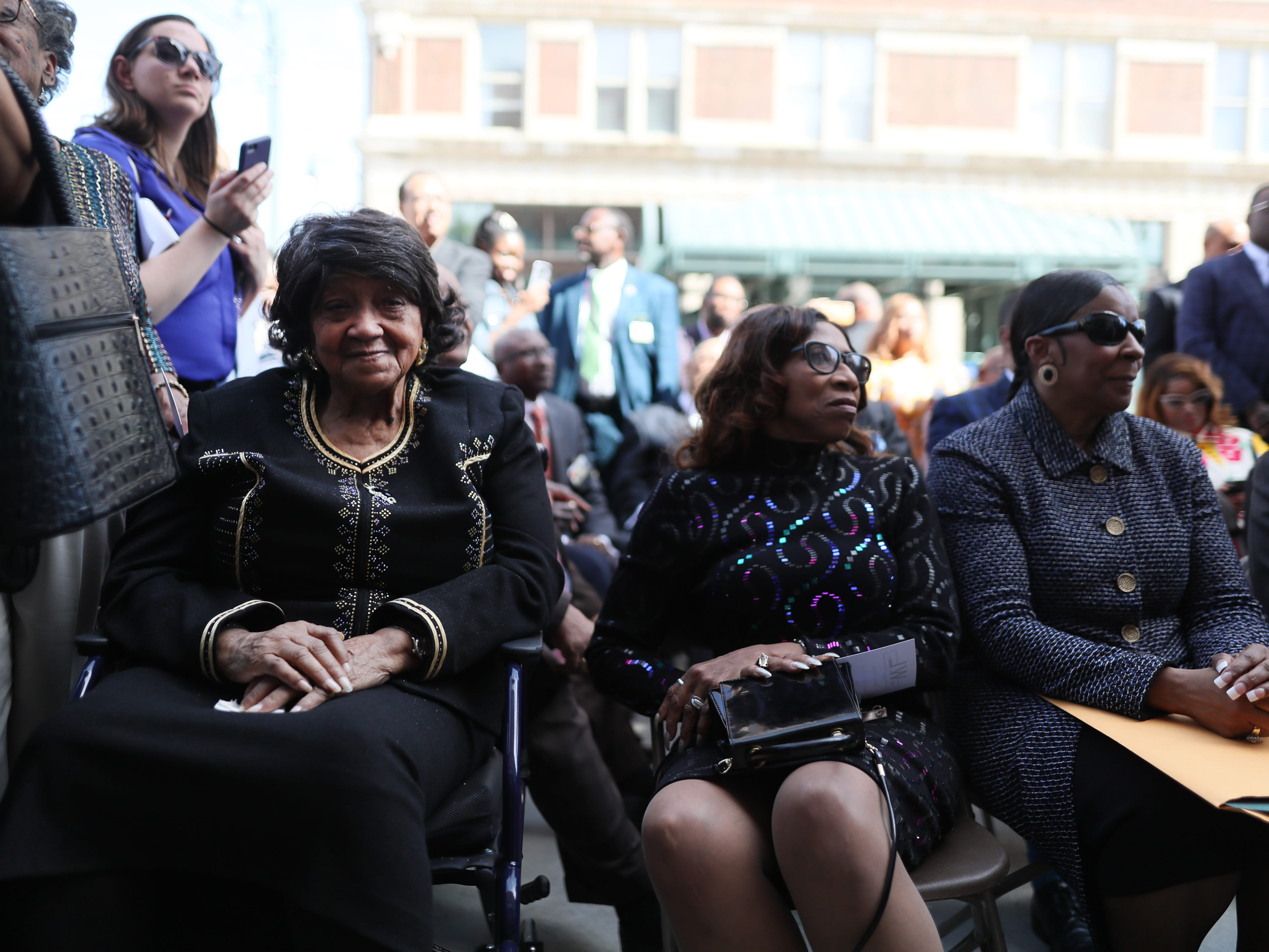 Ida M. Porter, left, wife of the late Bishop W.L. Porter joins a ceremony renaming downtown's Adler Building as 'The W.L.' in his honor on Wednesday, April 10, 2019.