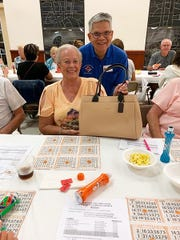 On Thursday, April 4, the Knights of Columbus San Marco Council #6344 hosted a Bingo Night in the San Marco Parish Center. Above, Coach bag winner Dawne Eaton of Michigan.
