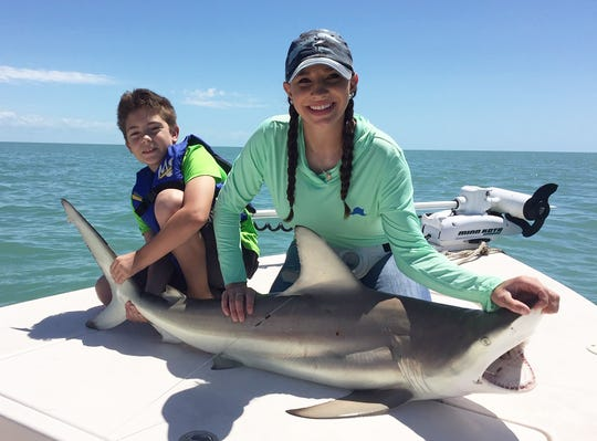 Sarah-Marie Smith and Kayden got this blacktip shark to the boat using mullet for bait. It was caught tagged and released.