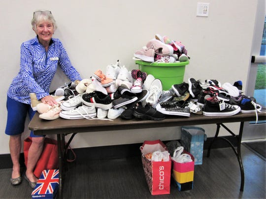Italian American Society's Joyce Imbrogno, with a collection of sneakers for the non-profit organization Laces of Love.