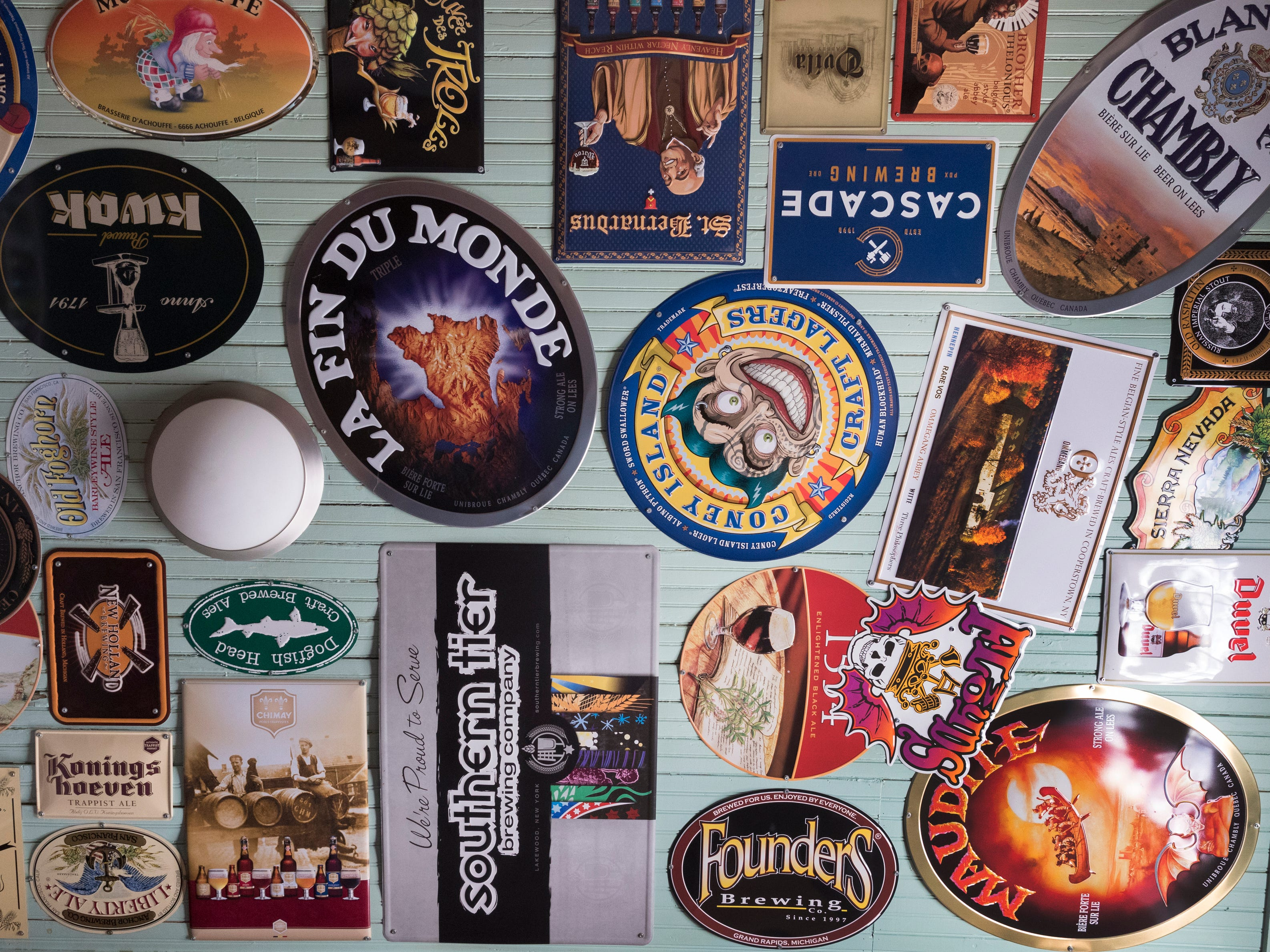 A ceiling covered with beer signs is shown Tuesday, April 9, 2019 at the soon-to-open Trailer Park Tavern, 2989 S. Kinnickinnic Ave. in Milwaukee, Wis. The bar, owned by Jordon (CQ) Bledsoe, is to open in May.