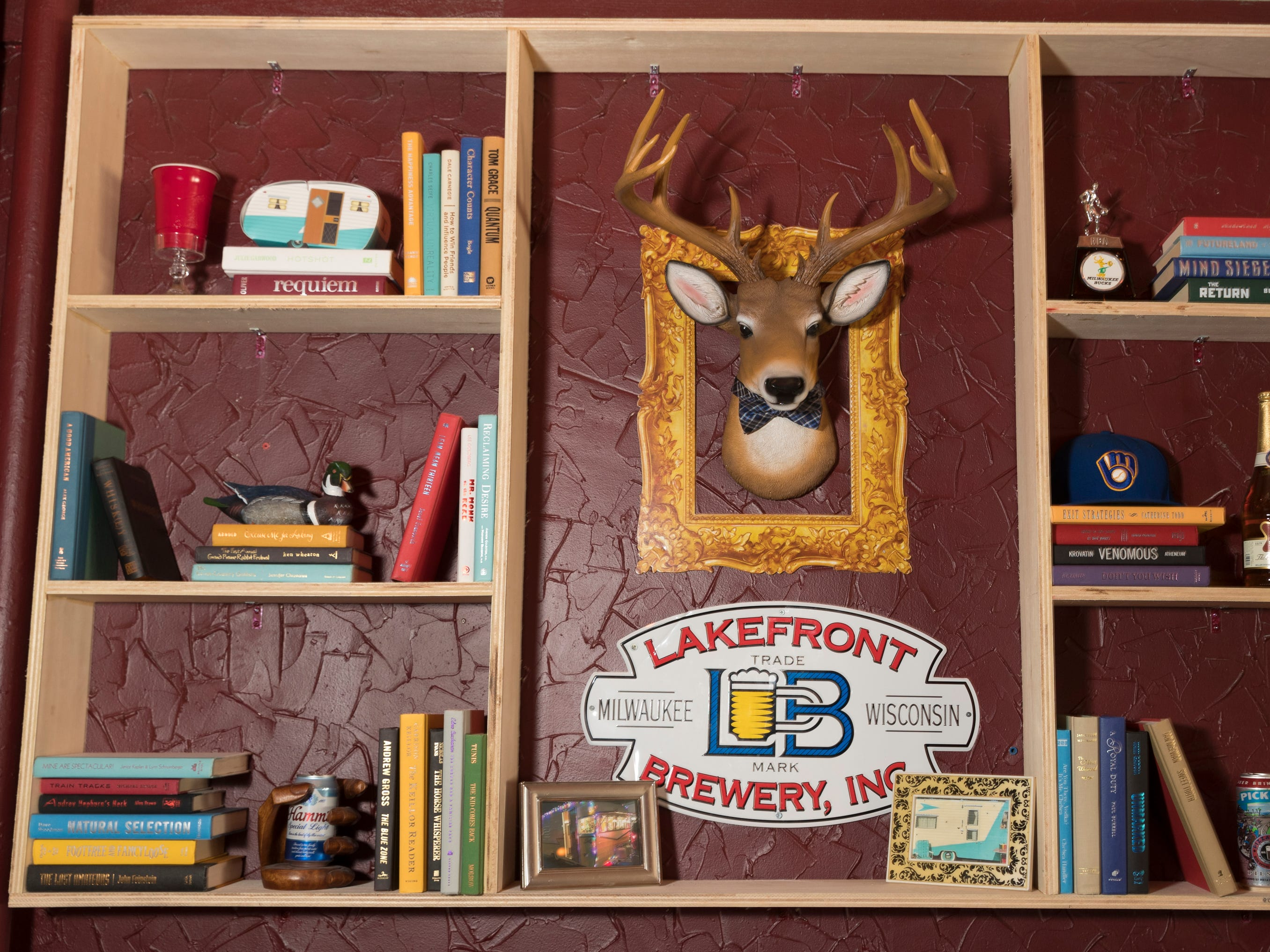 A decorated wall featuring a fake deer head is shown  Tuesday, April 9, 2019 at the soon-to-open Trailer Park Tavern, 2989 S. Kinnickinnic Ave. in Milwaukee, Wis. The bar, owned by Jordon (CQ) Bledsoe, is to open in May.