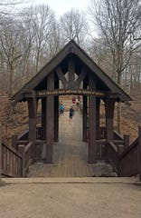 "The entrance to the Seven Bridges Trail at Grant Park in Milwaukee includes the inscription: ""Enter this wild wood and view the haunts of nature,"" from a poem by William Cullen Bryant."