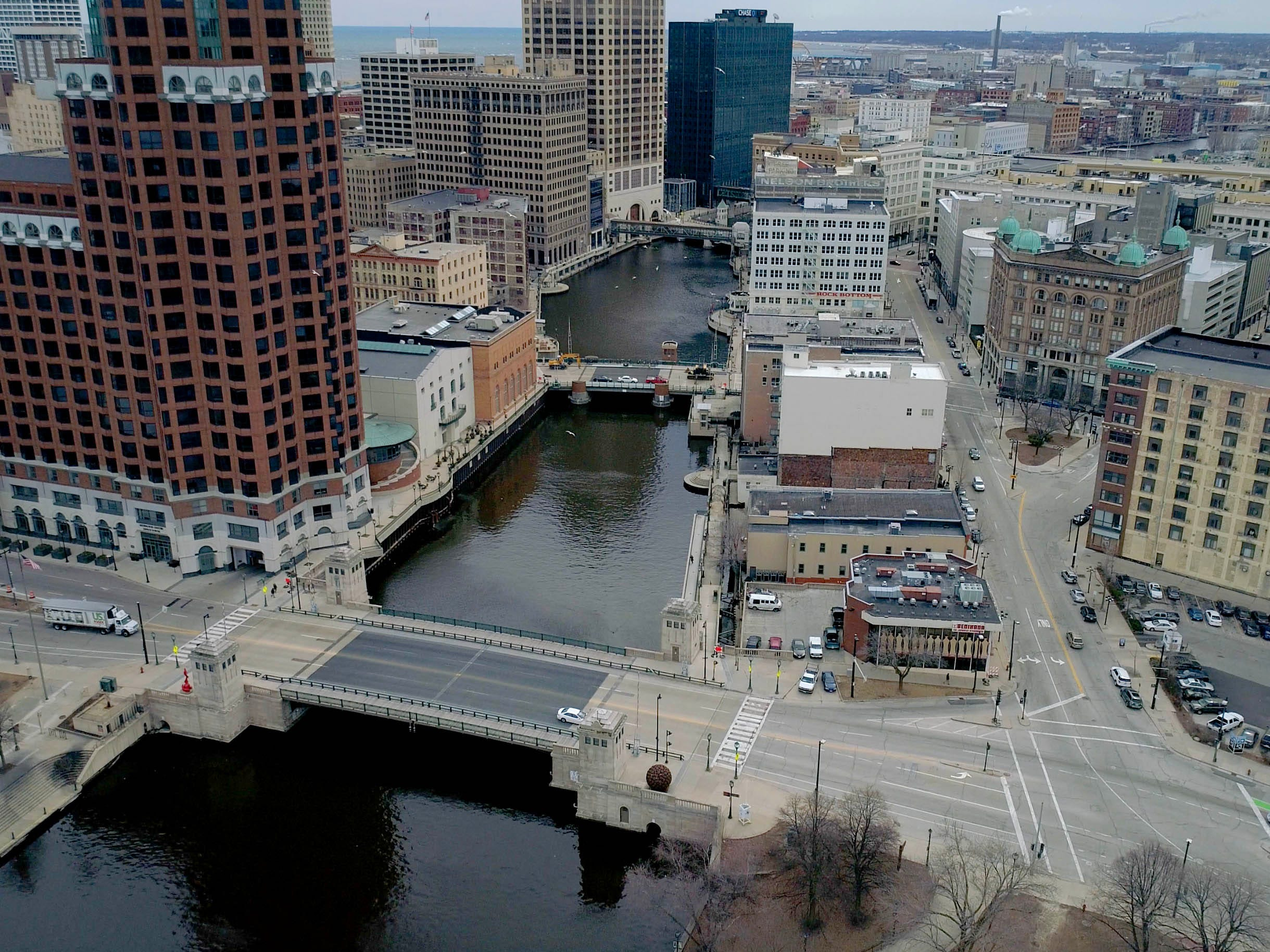 The Milwaukee River across the Kilbourn Ave. bridge (front) and the Wells. St. bridge in Milwaukee.