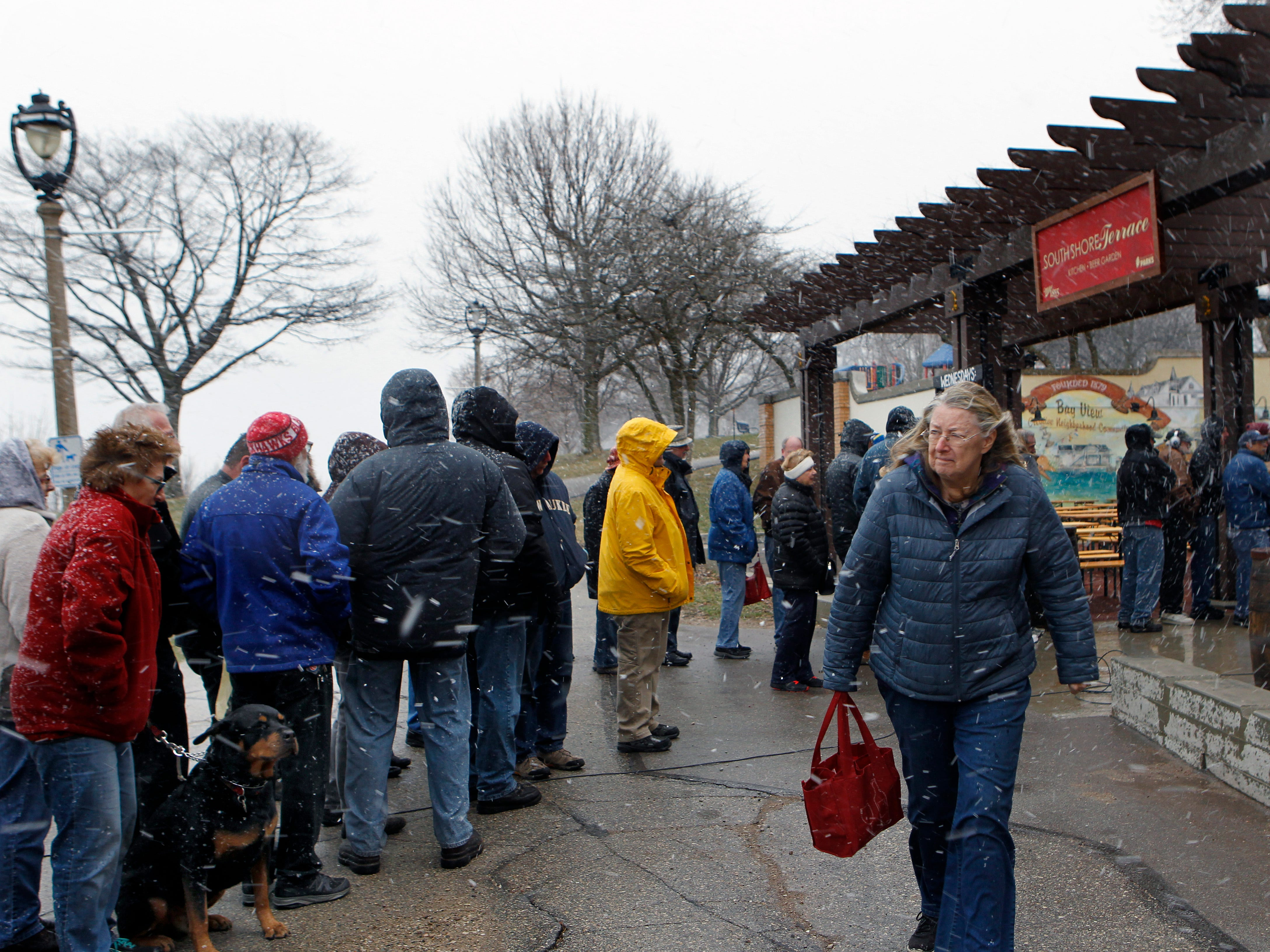 A crowd including lined up at the kick off of the beer garden season at South Shore Terrace on Wednesday, April 10, 2019.   Several hundred turned out for the event that featured free beer and food.