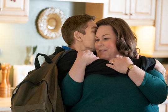 "John (Marcel) embraces his mother (Chrissy Metz) in a tender moment before a tragic accident changes their lives and challenges their faith in ""Breakthrough."""