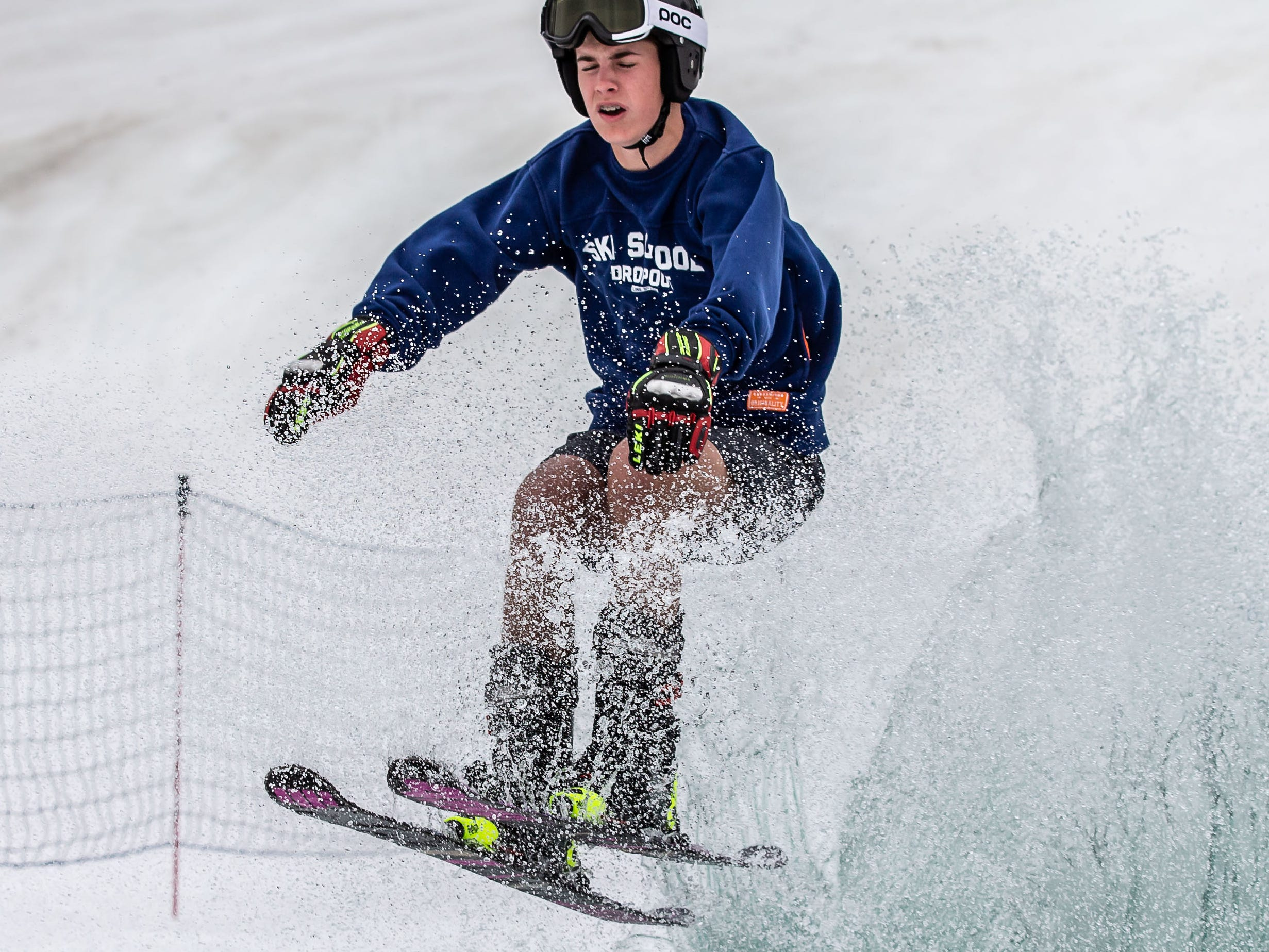 Braden Race, 15, of Okauchee launches out of the pond during the 2nd annual Pond Skim at Ausblick Ski Hill in Sussex on Saturday, April 6, 2019. The pond skim is held on the last day of the season as club members celebrate another fun-filled year on the slopes.