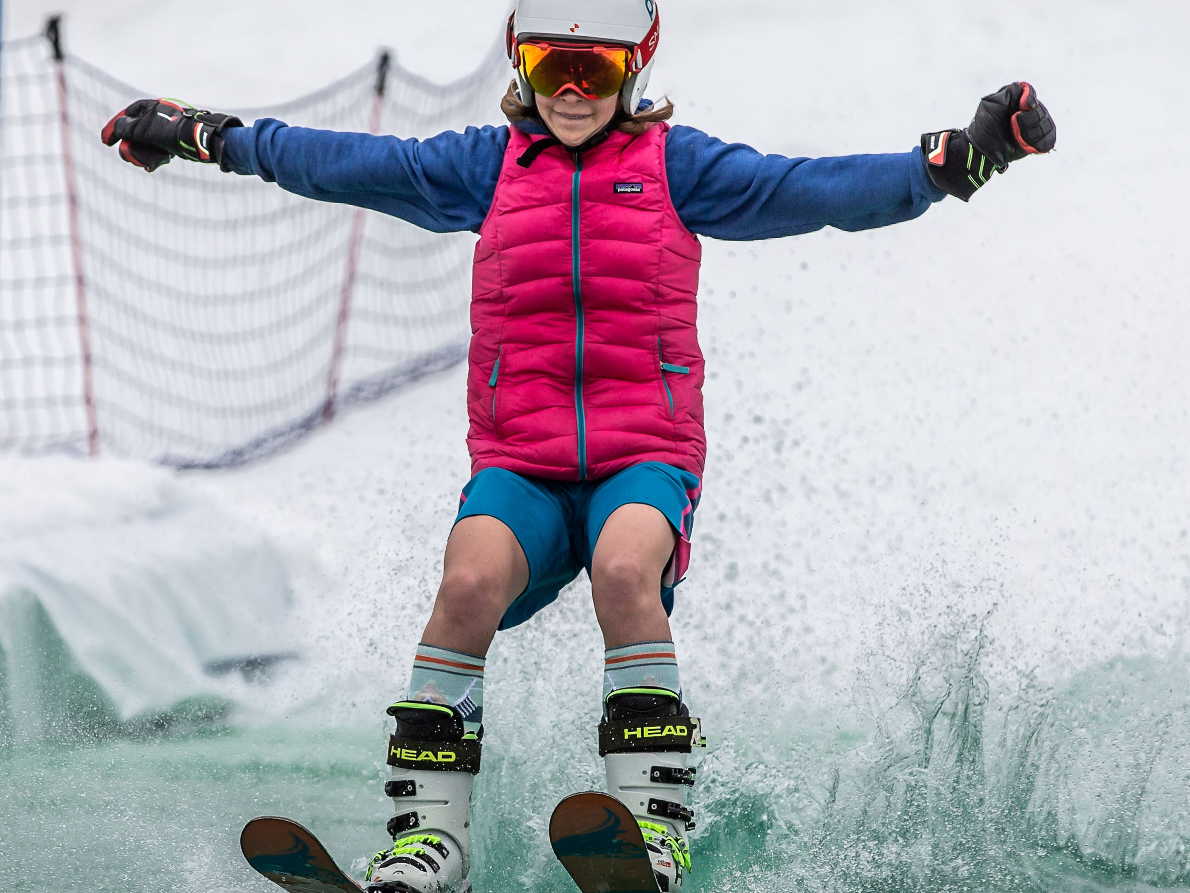 Monica Wawrzyn, 12, of Delafield shows how it's done during the 2nd annual Pond Skim at Ausblick Ski Hill in Sussex on Saturday, April 6, 2019. The pond skim is held on the last day of the season as club members celebrate another fun-filled year on the slopes.