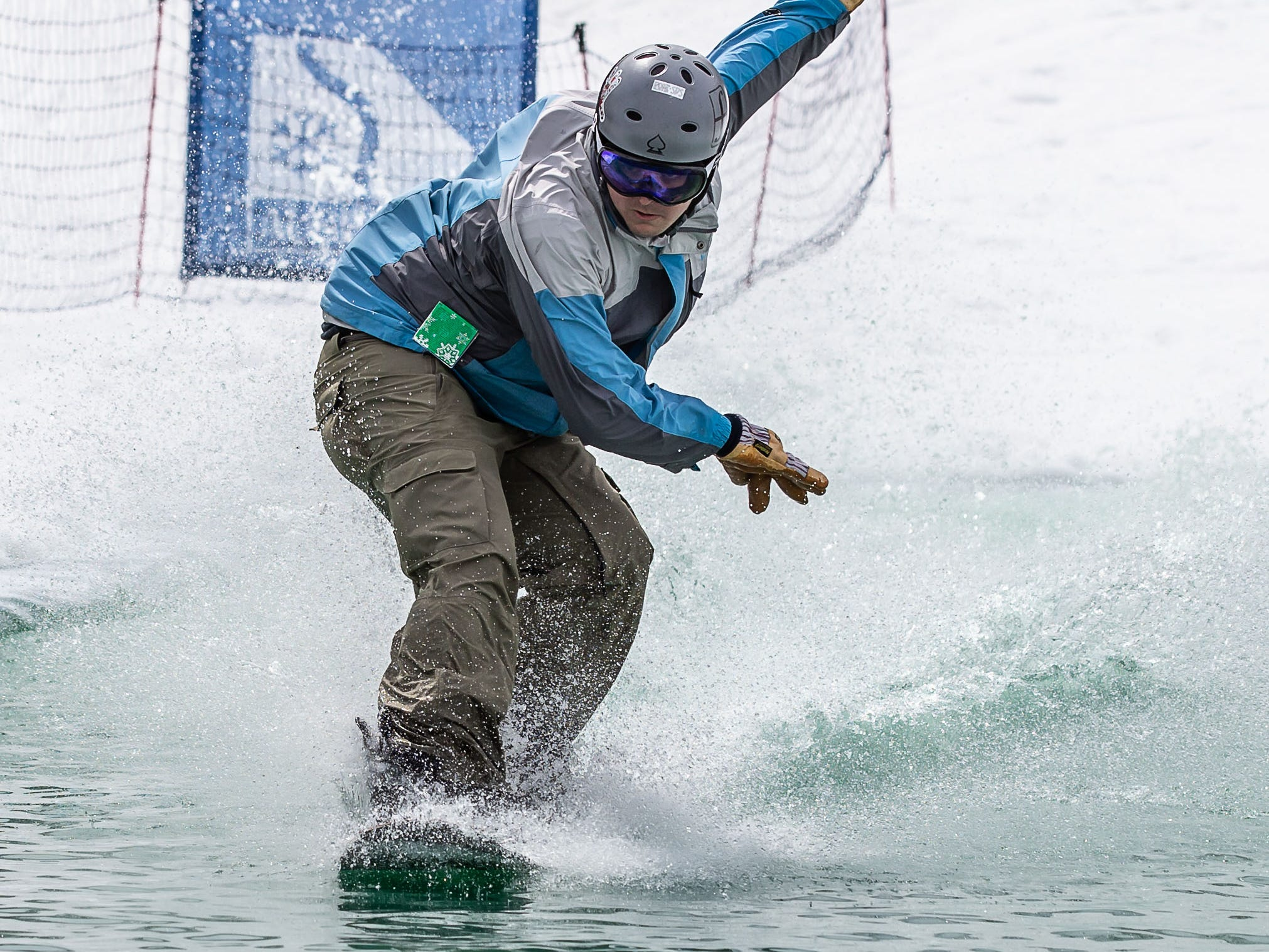 Lucas Healy of Carpentersville, IL hangs ten on his snowboard during the 2nd annual Pond Skim at Ausblick Ski Hill in Sussex on Saturday, April 6, 2019. The pond skim is held on the last day of the season as club members celebrate another fun-filled year on the slopes.