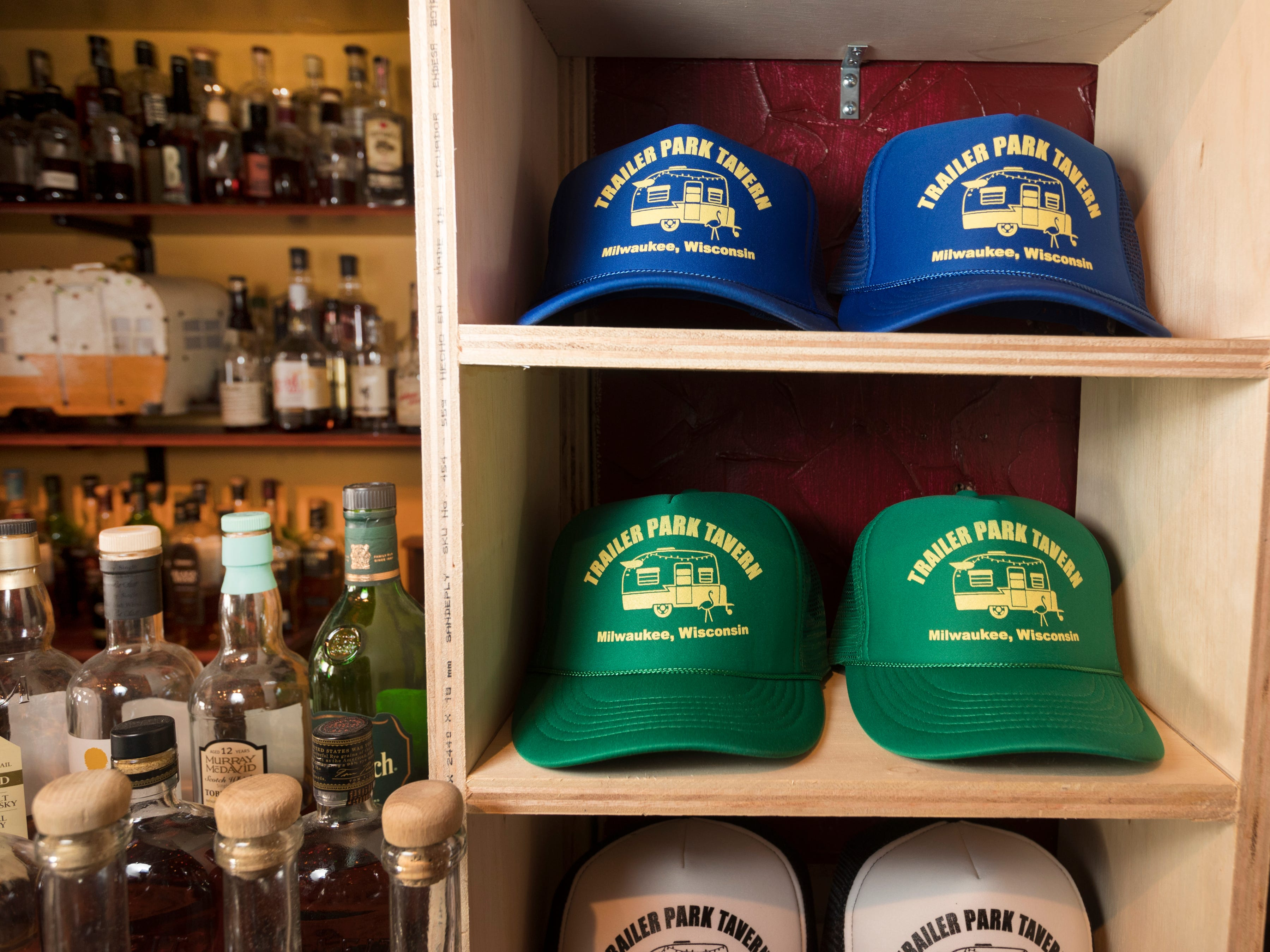Souvenir hats are on display Tuesday, April 9, 2019 at the soon-to-open Trailer Park Tavern, 2989 S. Kinnickinnic Ave. in Milwaukee, Wis. The bar, owned by Jordon (CQ) Bledsoe, is to open in May.