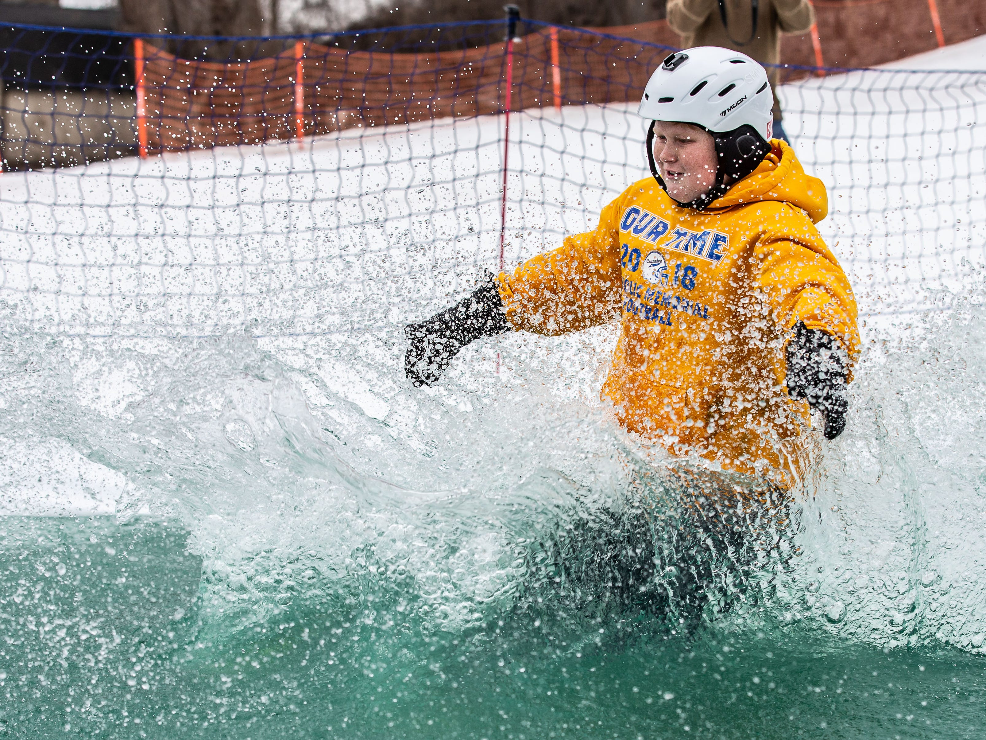 TJ Steidl, 14, of Oconomowoc sinks just short of the finish during the 2nd annual Pond Skim at Ausblick Ski Hill in Sussex on Saturday, April 6, 2019. The pond skim is held on the last day of the season as club members celebrate another fun-filled year on the slopes.
