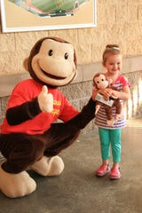 Several theme nights at Timber Rattlers games include appearances by PBS KIDS characters such as Curious George.