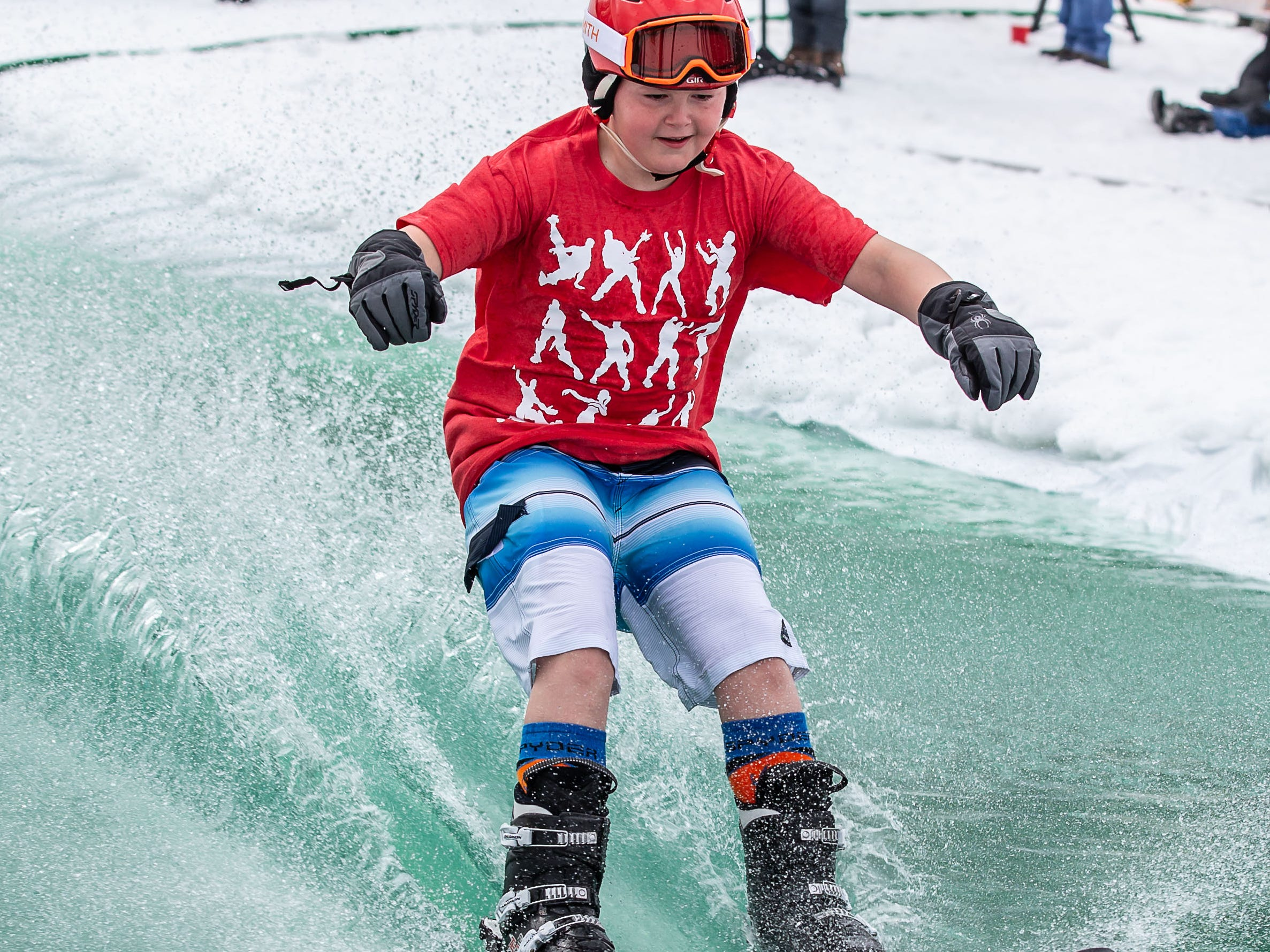 Charles Schwister, 11, of North Lake makes a successful run during the 2nd annual Pond Skim at Ausblick Ski Hill in Sussex on Saturday, April 6, 2019. The pond skim is held on the last day of the season as club members celebrate another fun-filled year on the slopes.