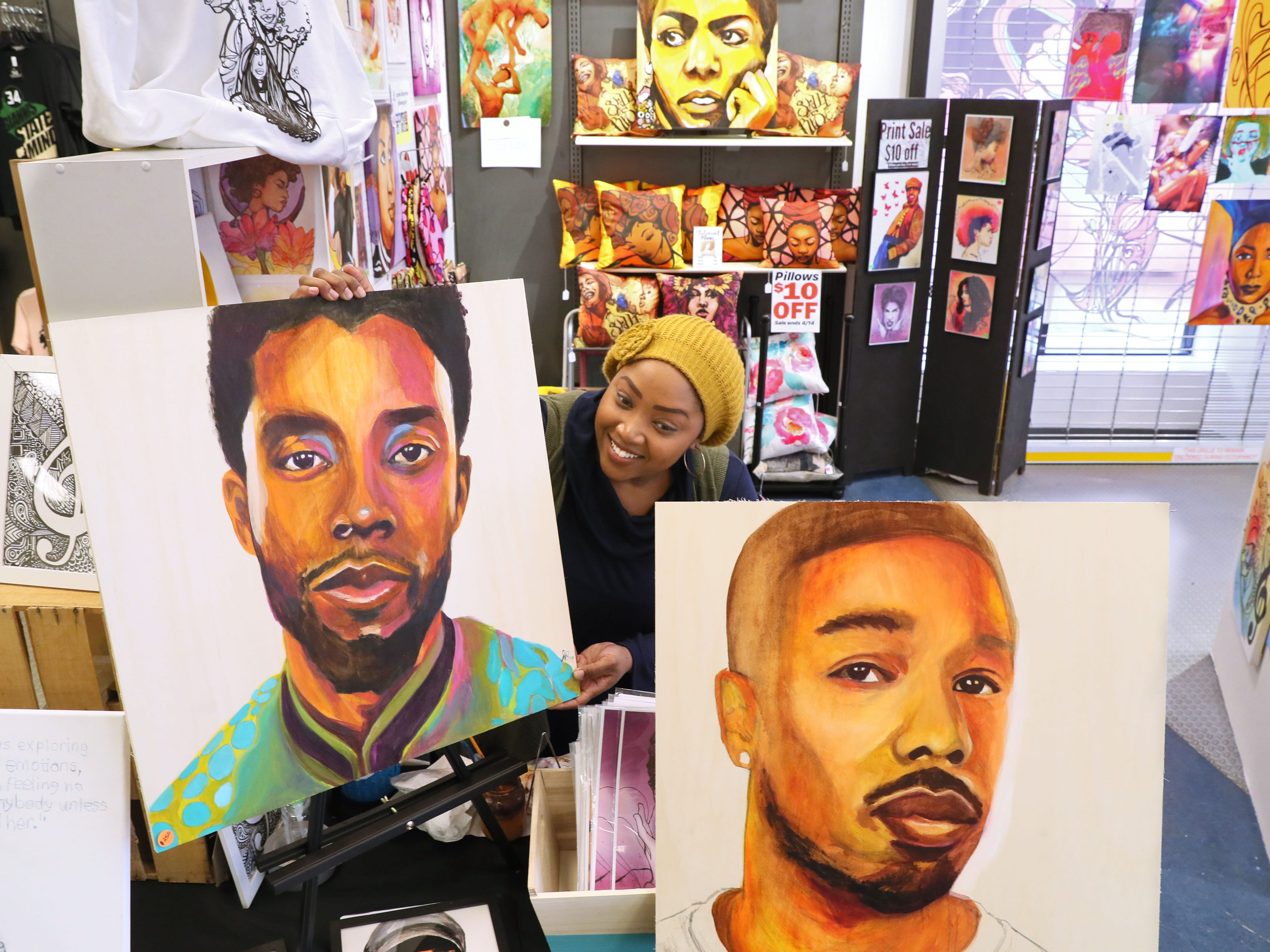 Artist Jasmine Barmore shows some celebrity portraits at The Bronzeville Collective.